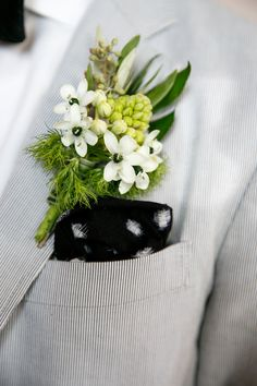 floral boutonniere, photo by Modern Wedding Photography http://ruffledblog.com/notwedding-nyc #boutonnieres #grooms