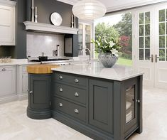 http://www.tomhowley.co.uk/kitchens/sleek-painted-kitchen/