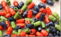 paper beads on plastic tubing