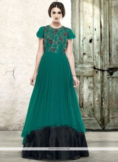 You are confident to make a strong style statement with this black and teal fancy fabric and net readymade gown . The wonderful attire creates a dramatic canvas with extraordinary embroidered and resh...