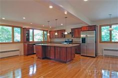 What an open kitchen... with beaming hardwood floors!
