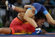 Aline Ferreira of Brazil is cradled by Rio Watari of Japan during the women's…
