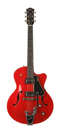 Dream Archtop Guitar. Made in Canada with North American Woods. Flame Maple top in Cherry Red. So very pretty and sounds awesome.