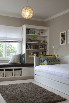 This, but re-worked for each boys' room. Bookcases on both sides of window BUT one side would be half headboard then bookcase from headboard top up to ceiling. The Edam house's tall windows w/more space above than below means storage built-in over top, connecting the two bookcases above the window rather than below.