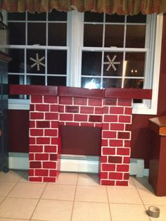5 empty printer paper boxes, 3 of the covers, duct tape, spray paint, craft paint and a long weekend = teachers request fulfilled!   A great diy fireplace for the kiddos to read next too!!!