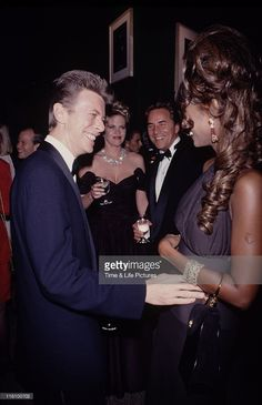 Singer and musician David Bowie with supermodel Iman, and actors Melanie Griffith and Don Johnson, circa 1992.