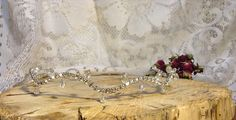 Bridal Rhinestones Headpiece  This shining headpiece will beautify your hairstyle in an important day for you!  Item description:  - wire; - rhinestones d=4 mm; - teardrop glass beads; - height approx. 0.8 (2 cm); - length approx. 17 (44 cm);  The Headpiece is flexible so you can give it various forms. The item can be attached to your hair with satin ribbon. Lets make something special! I will help to realize your ideas. Free to contact me about a combination of colors that you like and ...