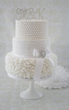 Beautiful all white wedding cake with ruffles, stencilling and pearls - by CJ Sweet Treats
