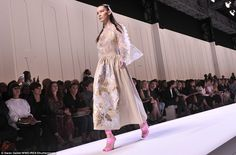 It's a cover-up: Bella took to the runway in a notably more conservative number…