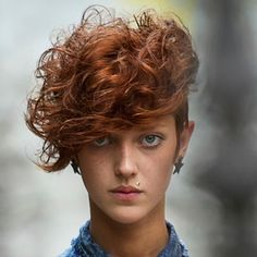 To infuse your short style with hipster elements, perfect the art of carelessness. You want your hair to look slightly untamed and a little left of center. One great example is the curly mohawk. This style blends short and long together by keeping the sides closely shaved and the top section full of big curls. This style shouldn't look prim and proper. You want it to be a total explosion of curls!