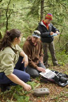 Our dedicated colleague, David Tharp (in the center), checking a trail camera with Ally Nauer and Patty ten Boom Byrnes