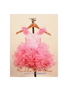 Elegant Ruffles Baby Pink Little Girl Pageant Dress With Hand Made Flowers Scoop Neck- $146.99 http://www.fashionos.com http://www.facebook.com/quinceaneradress.fashionos.us The lovely scoop neck dress is stunning with glittering sequins and appliques on the bodice and fabulous flowers at the straps.The full skirt is phenomenal with ruffled tiers that make the silhouette extremely sweet. The zipper up in back completes the look.