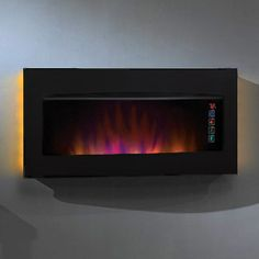 This is mandatory in my new bathroom! LED fireplace with remote. Yes please!!!