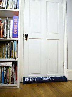 Make a handy denim DIY draught excluder for your doors or windows by upcycling an old pair of jeans. Add some fun by stenciling a few puns on to the denim. Door Draught Stopper, Draft Stopper, Folding Jeans, Patriotic Bunting, Denim Scraps, Pillos, Out Of The Closet, Hanging Organizer, Sewing Pillows