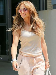 Jennifer Lopez was simply glowing in an all-peach-hued ensemble, topped off with aviators with matching rose flash lenses!