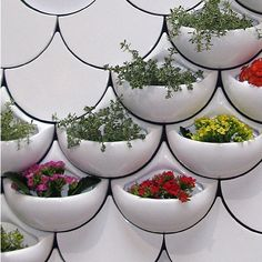 Spied on MoCoLoco! Puerto Rican designer Maruja Funetes's Green Pockets: recycled-content ceramic wall tiles that double as planters or containers for…whatever. Brilliant! I love the interlocking fishscale profiles. Just a prototype for now; I am eagerly anticipating the commercial launch.