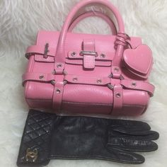 """Luella Bartley Baby Giselle Pink Leather MINIBAG Luella Bartley Baby Giselle Pink Leather Silver Tone Satchel Handbag This Is the Smallest Size Giselle Bag. Dust Bag NOT Included Hardware: Silver Tone and 2 Leather Dangling Hearts  Closure: Strap Closure Interior Pockets: One Side Zipper Pocket Exterior Pockets: None Lining: Black Cotton Lined Made In: Turkey Handle: Double Rolled Top Handles Color: Pink Material: Leather Height: 6"""" Length: 8.5"""" Depth: 4"""" Strap Drop: 2"""" Excellent Used…"""