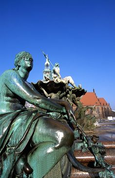 Neptunbrunnen (Neptune`s fountain) on Berlin`s Alexanderplatz with St.-Marien Kirche in the background