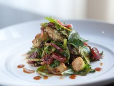 Carmelized brussels sprouts, Chinese sausage, greens, and candied Fresnos in a sweet and sour vinaigrette- Burritt Room and Tavern, San Francisco
