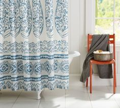 Lori Paisley Shower Curtain   Pottery Barn   $69   blue paisley pattern on white organic cotton