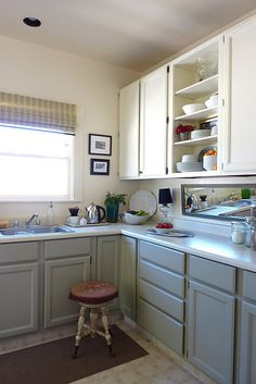 The clean lines and use of one color up and a different one down in this near-neutral palette would bring a clean modern feel that would not be out of place in a home that keeps some if its original architectural charm particularly in the pre-50s period. I think. ;)