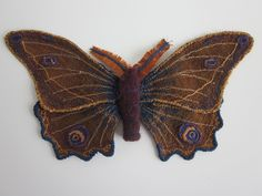 Moth I by CMWyvern. Free-motion embroidery on silk wings and felt body. Inspired by Annameike Mein.