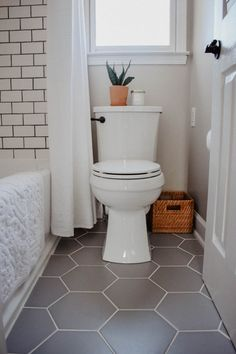 Modern Boho Bathroom Remodel | House On Longwood Lane #baskettrashcan #whitesubwaytile #smallbathroom #smallbathroomremodel #designingwithplants #interiordesigner #nashvilleinteriordesigner#subwaytile #subwaytileshower #subwaytilebathroom