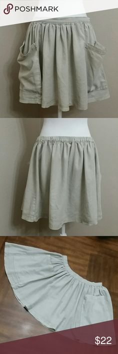 """NWOT Ecote Khaki Boho Linen Skirt w Drapey Pockets Adorable little boho skirt with oversized droopy pockets in the front. Very flirty cut with elastic backside waistline and plain front waistband. Tagged L .With a tapemeasure the top hem laying flat measures 14"""" across. Length 15.5"""". Pockets 9""""w X 9.5"""" L. New without tags and never worn. Ecote Skirts Mini"""