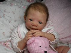 Reborn art involves making dolls look like real life babies.   Deborah King is the reborn artist behind www.reborn-baby.com and she specialises in this art.
