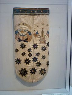 Sailor's embroidered ditty bag. Cotton and linen. United States. It features a lighthouse, the Washington Memorial at Baltimore, and other patriotic symbols. Date late 19th century