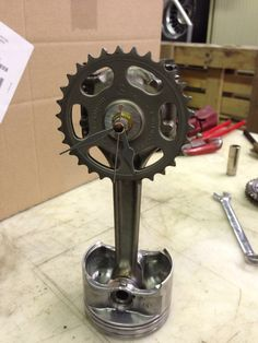 Piston con rod sprocket gear clock