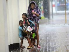 Credit: Stringer/Reuters Here, a mother takes refuge with her children as Typhoon Haiyan hits Cebu city