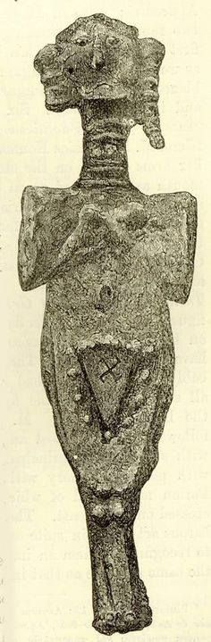 Abracadabra article - photo: the numinous vulva, inscribed with Sauwastika, on a lead effigy, found 23 feet below the surface in Troy in Ancient Anatolia