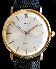 rolex-precision-18k-solid-gold-dress-watch-2 This represents that they think it is time that Dave Beckmann & I be married and the chosen date is saved! Thank you! We are so happy!