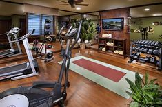 Inviting and warm with hardwood floors and a must have TV for my home workout DVD's. #P90x3 #pushplay #workoutathome www.KimOlsenFitness.com