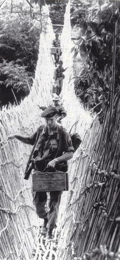 Green Beret with indigenous troops, in Dak To Vietnam, 1965. ~ Vietnam War