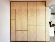 This wall set is made of birch plywood. It is a real trompe-l'oeil made to measure and makes it possible to conceal a door while transforming the lost spaces of the wall into a bookcase or storage space. The lines ...