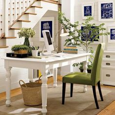 Office idea. White desk, green chair, natural accents.