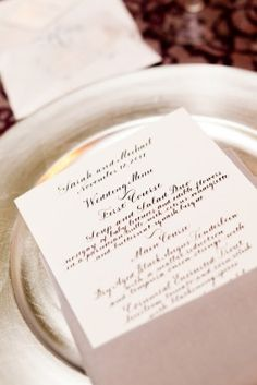 White calligraphy wedding menus. Photo by The Observatory