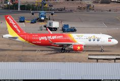 VietJetAir (VN) Airbus A320-214(WL) VN-A650 aircraft, with the stickers ''MINIONS only in Cinemas & EWnjoy Flying'' on the airframe, skating at Vietnam Ho Chi Minch City Tan Son Nhat International Airport. 05/07/2015. (MINIONS=a 2015 American 3D computer-animated film).