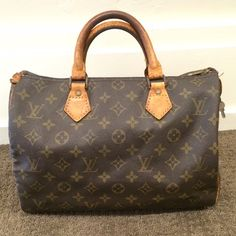 Authentic Louis Vuitton Speedy 30 The speedy is perhaps the most classic Louis Vuitton purse! The monogram canvas will go with everything! This speedy 30 is a vintage piece but is in good condition for its age. Comes with lock and key although previous owner locked the key in with the lock haha. Corners look good. Monogram canvas is in excellent condition. Inside is pretty clean with one ink again. One leather tab is missing. Zipper pull has been replaced with non-LV pull. Feel free to ask…