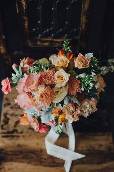 Bridal bouquet with peach flowers // The Bear and the Hare: Leoel and Dana's Wedding at Nosh