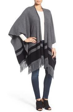 Bold stripes detail a wide, sweeping wrap crafted in sumptuous cashmere and trimmed in lavish fringe.