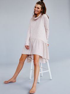 Ruffle Up Tunic | Luxe merino wool tunic features a dropwaist silhouette and an oversized, effortless fit. Ruffle detailing, high low hem and a dramatic cowl neck complete the look.