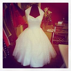 Ivory tulle spotty wedding dress.
