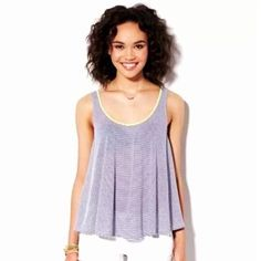 American Eagle Outfitters Aloha Blue Striped Tank New without tags, size XS. American Eagle Outfitters logo is marked out with a black marker on the inside of the shirt. Super soft thin jersey material. Blue & white stripes with green around neckline. American Eagle Outfitters Tops Tank Tops