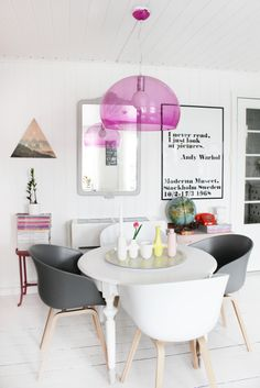 White dining area with pops of colour