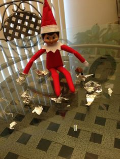 Ralph the elf coloured in my puzzle book it 39 s elf for Elf on the shelf chocolate kiss