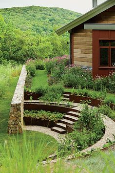 A terraced garden at Iron Mountain House, a home in Connecticut. Article about designer Thomas Woltz in WSJ.