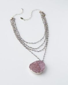 Mickey Lynn's unique pieces are designed and handcrafted by skilled artisans in her Atlanta atelier. A generous oval of natural (undyed) druzy crystal, like sparkling pink sugar, sweetens strands of shimmering itty-bitty labradorite gemstones.